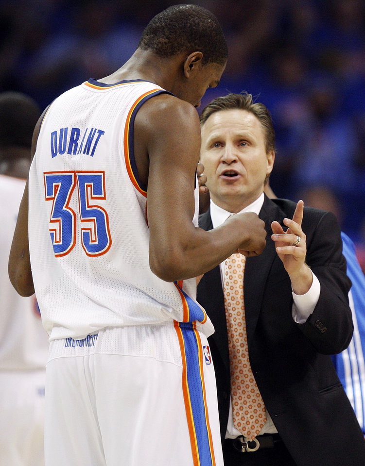 Oklahoma City head coach Scott Brooks talks to Kevin Durant (35) in the second half during game 7 of the NBA basketball Western Conference semifinals between the Memphis Grizzlies and the Oklahoma City Thunder at the OKC Arena in Oklahoma City, Sunday, May 15, 2011. The Thunder won, 105-90. Photo by Nate Billings, The Oklahoman