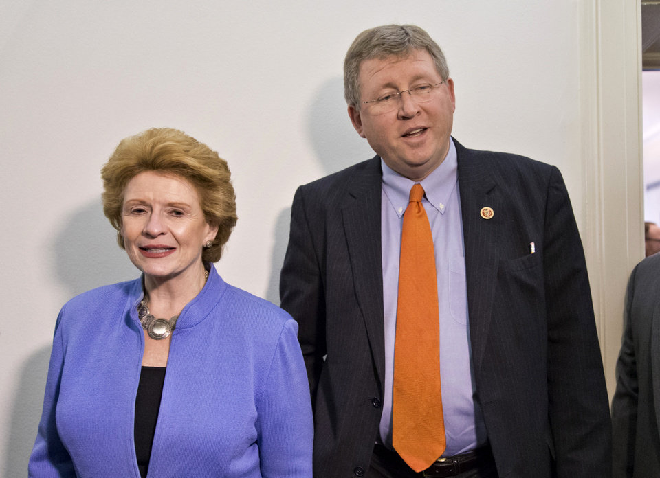 FILE - This Dec. 4, 2013 file photo shows Senate Agriculture Committee Chair Sen. Debbie Stabenow, D-Mich., left, and House Agriculture Committee Chairman Rep. Frank Lucas, R-Okla. on Capitol Hill in Washington. Farm-state lawmakers are pushing for final passage of the massive, five-year farm bill as it heads to the House floor Wednesday � member by member, vote by vote. There are goodies scattered through the bill for members from all regions of the country: a boost in money for crop insurance popular in the Midwest; higher cotton and rice subsidies for Southern farmers; renewal of federal land payments for Western states. There are cuts to the food stamp program � $800 million a year, or around 1 percent � for Republicans who say the program is spending too much money, but they are low enough that some Democrats will support them.  (AP Photo/J. Scott Applewhite, File)