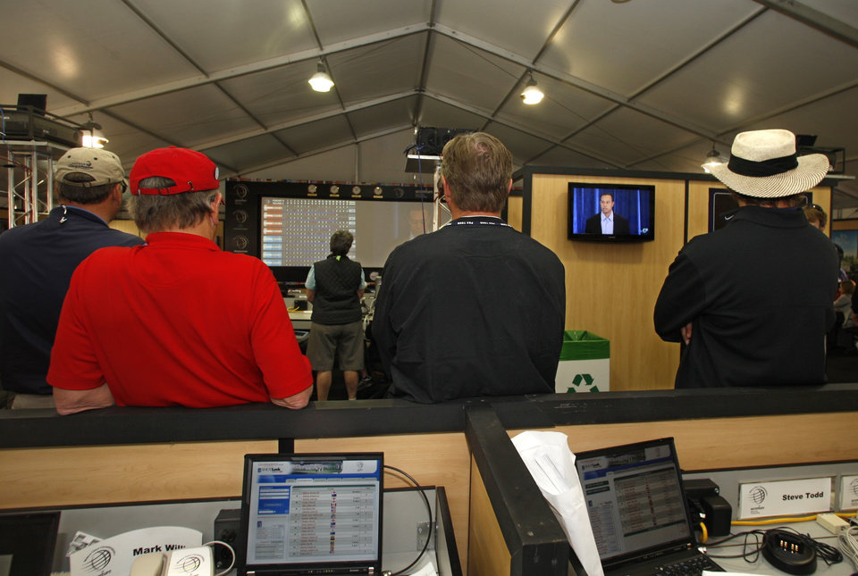 Photo - Tiger Woods appears on the television screens in the press pavilion at Match Play Championship golf tournament Friday, Feb. 19, 2010, in Marana, Ariz. Woods has apologized for having affairs and says he is unsure when he will return to competitive golf. Woods spoke for more than 13 minutes Friday, Feb. 19, 2010,  from the clubhouse at the TPC Sawgrass, home of the PGA Tour.  (AP Photo/Lenny Ignelzi) ORG XMIT: AZLI103