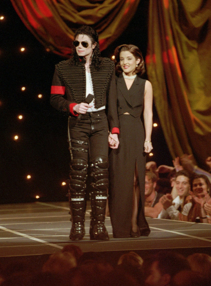 Photo - FILE - In this Thursday, Sept. 8, 1994 file picture, Michael Jackson and Lisa Marie Presley-Jackson acknowledge applause from the audience after coming out onstage to open the 11th Annual MTV Video Music Awards at New York's Radio City Music Hall. A person with knowledge of the situation said Thursday, June 25, 2009 that Jackson has died in Los Angeles at age 50. (AP Photo/Bebeto Matthews) ORG XMIT: NYET717