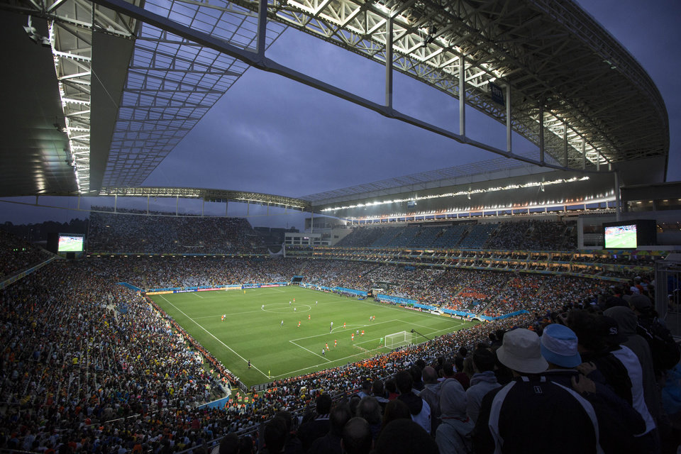 Photo - Soccer fans watch the World Cup semifinal match between the Netherlands and Argentina in the Itaquerao Stadium, in Sao Paulo Brazil, Wednesday, July 9, 2014. The match remained scoreless at haltime (AP Photo/Felipe Dana)