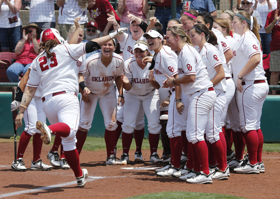 Photo - Sooner hitter Brittany Williams is greeted at home after a home run at the Norman Regional of the 2013 NCAA Division I Softball Women's College World Series as the University of Oklahoma (OU) Sooners play the Arkansas Razorbacks at Marita Hines Field on Saturday, May 18, 2013  in Norman, Okla. Photo by Steve Sisney, The Oklahoman