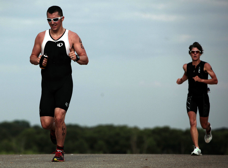 Photo - Right: Steve Calonkey runs during the Arcadia Lake Triathlon and Aquabike in Edmond Park at Arcadia Lake. The event included swimming, bicycling and running.