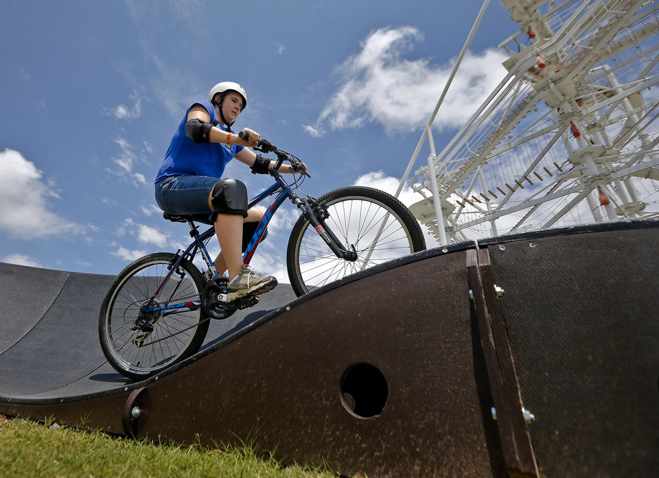 Photo -  Cheyenne Cline, of Pennsylvania, rides a bike on the pump track at OKC Riversport Adventures on Thursday in Oklahoma City. Photo by Chris Landsberger, The Oklahoman   CHRIS LANDSBERGER -