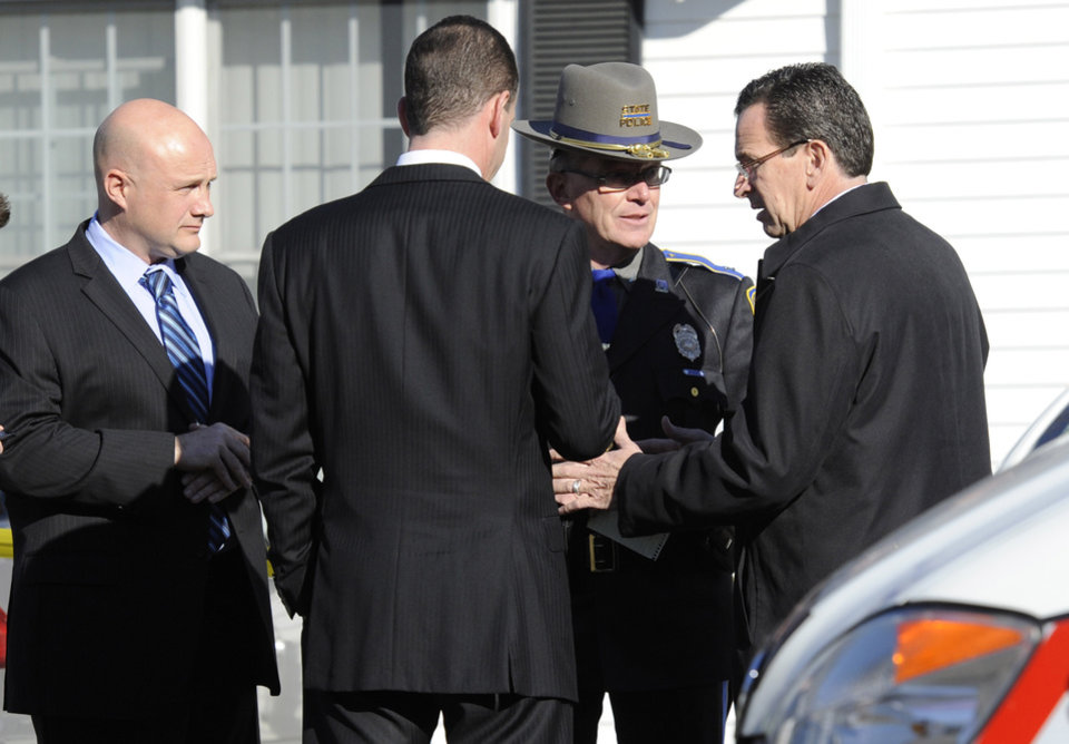 Gov. Dannel P. Malloy, right, talks with officials at a staging area following a shooting at the Sandy Hook Elementary School in Newtown, Conn., about 60 miles (96 kilometers) northeast of New York City, Friday, Dec. 14, 2012. An official with knowledge of Friday\'s shooting said 27 people were dead, including 18 children. (AP Photo/Jessica Hill)
