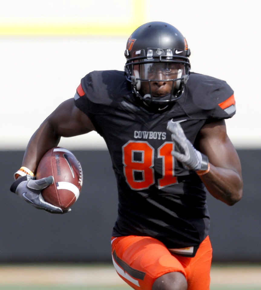 Photo - Oklahoma State's Justin Blackmon (81) runs up field during the first half of the college football game between the Oklahoma State University Cowboys (OSU) and the University of Kansas Jayhawks (KU) at Boone Pickens Stadium in Stillwater, Okla., Saturday, Oct. 8, 2011. Photo by Sarah Phipps, The Oklahoman