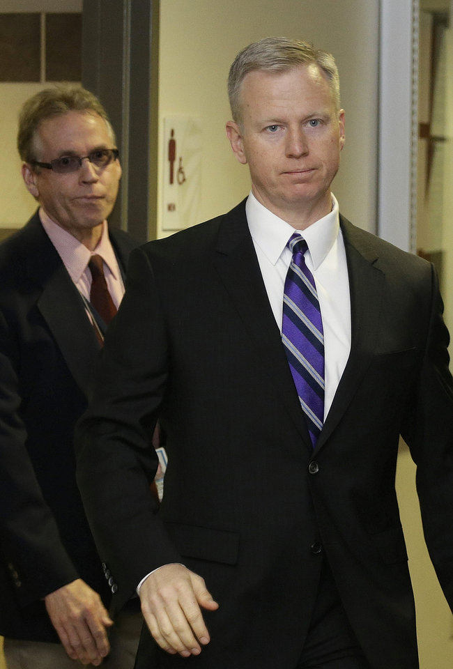 Photo - District Attorney George Brauchler arrives at district court for a hearing in the case of Aurora theater shooting suspect James Holmes in Centennial, Colo., on Monday, April 1, 2013. Brauchler announced he will seek the death penalty against Holmes. (AP Photo/Ed Andrieski)
