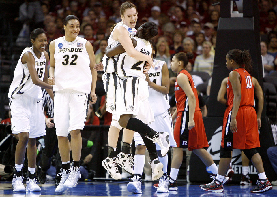 Purdue's Jodi Howell, center, and FahKara Malone celebrate their win in the NCAA women's basketball tournament game between Rutgers and Purdue at the Ford Center in Oklahoma City, Sunday, March 29, 2009.  PHOTO BY BRYAN TERRY, THE OKLAHOMAN