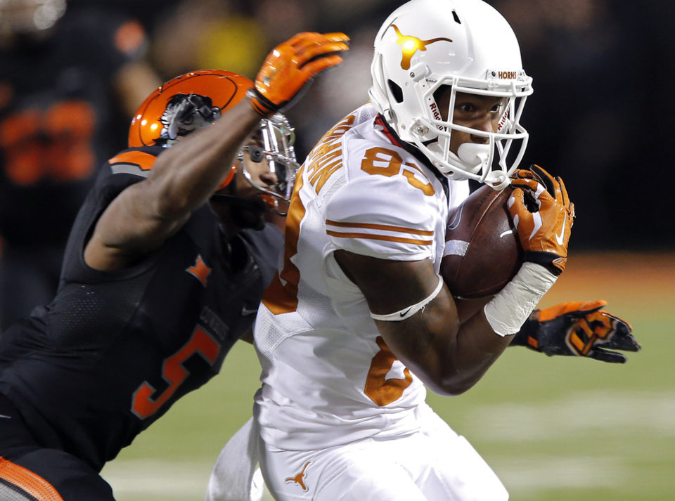 Photo - Texas' Armanti Foreman (83) makes a catch in front of Oklahoma State's Jerel Morrow (5) during the college football game between the Oklahoma State University Cowboys (OSU) the University of Texas Longhorns (UT) at Boone Pickens Staduim in Stillwater, Okla. on Saturday, Nov. 15, 2014.  Photo by Chris Landsberger, The Oklahoman