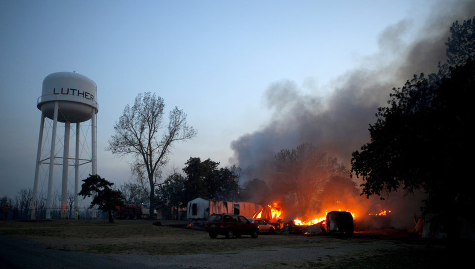 Photo - A home burns in Luther, Okla., after wildfire moved through the area on Friday, August 3, 2012. Photo by Bryan Terry, The Oklahoman