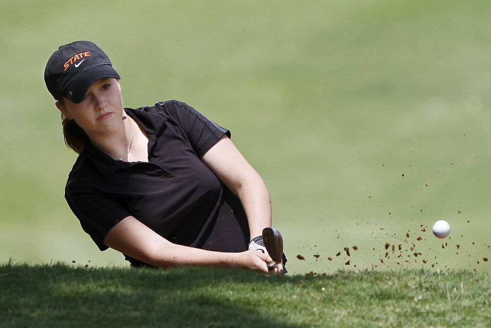Sage Watson of Frederick High School hits the ball out of a sand trap near the 18th green during Girl's Class 2A State Golf Tournament at Trosper Park Golf Course on Wednesday, May 2,  2012.    Photo by Jim Beckel, The Oklahoman