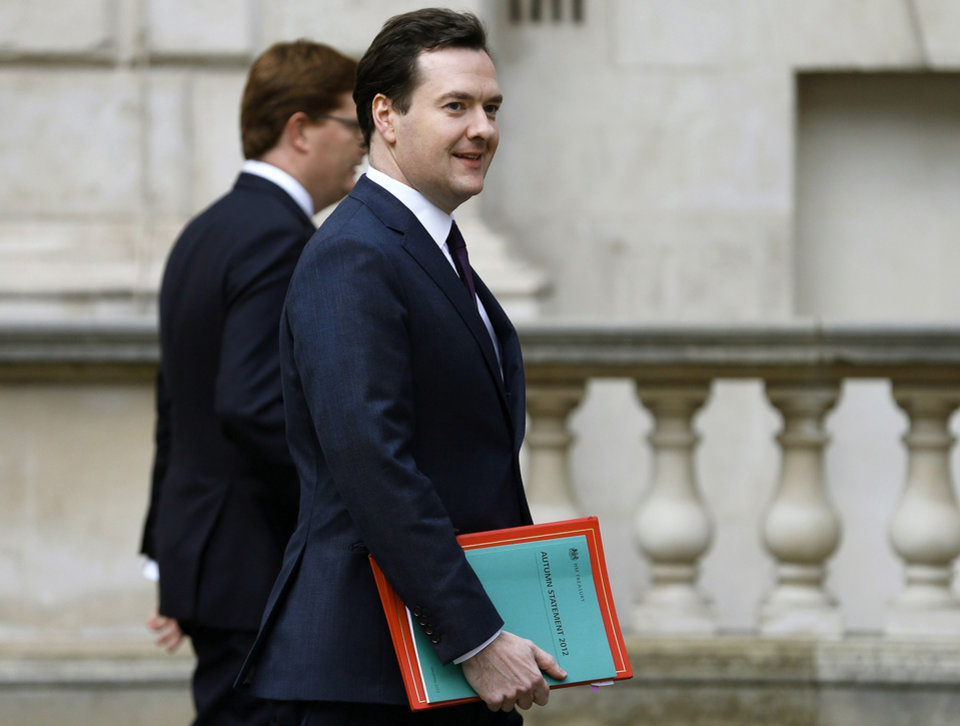 Britain\'s Chancellor of the Exchequer, George Osborne, right, walks with Chief Secretary to the Treasury, Danny Alexander, to deliver the half-yearly budget statement to parliament in London, Wednesday Dec. 5, 2012. Britain\'s Treasury chief, George Osborne, unveiled plans to kick-start the U.K.\'s moribund economy when he presented his updated budget policies to lawmakers. (AP Photo/Andrew Winning, Pool)