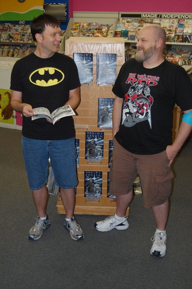 Photo - Writer Jackson Compton, left, and artist Jerry Bennett pose at a local comic-book store.  Photo by Annette Price, for The Oklahoman.