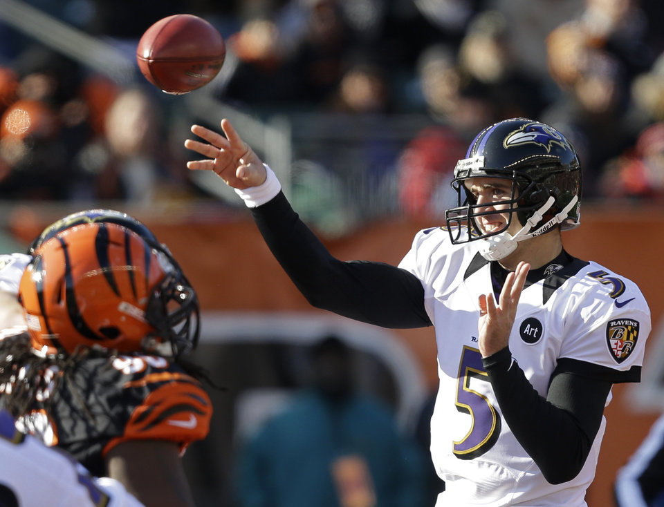 Photo - Baltimore Ravens quarterback Joe Flacco (5) passes against the Cincinnati Bengals in the first half of an NFL football game on Sunday, Dec. 30, 2012, in Cincinnati. (AP Photo/Al Behrman)