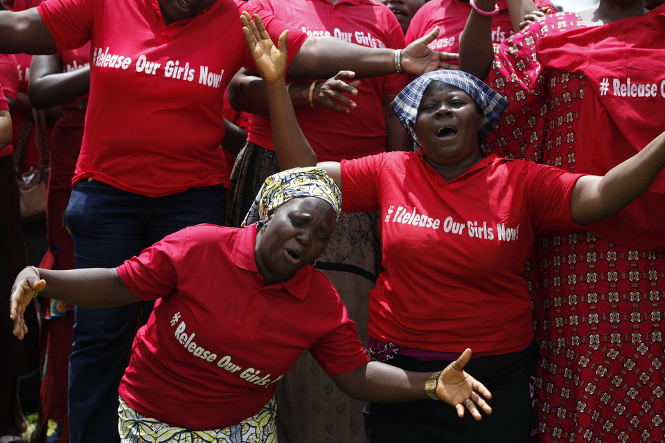 Photo - FILE - In this file photo taken on Tuesday, May 27, 2014, Women attend a prayer meeting calling on the government to rescue the kidnapped girls of the government secondary school in Chibok, in Abuja, Nigeria. Extremists have abducted 91 more people, including toddlers as young as 3, in weekend attacks on villages in Nigeria, witnesses said Tuesday, June 24, 2014, providing fresh evidence of the military's failure to curb an Islamic uprising and the government's inability to provide security. The victims included 60 girls and women, some of whom were married, and 31 boys, witnesses said. A local official confirmed the abductions, but security forces denied them. Nigeria's government and military have been internationally embarrassed by their slow response to the abductions of more than 200 schoolgirls who were kidnapped April 15 and remain captive. (AP Photo/Sunday Alamba,File)