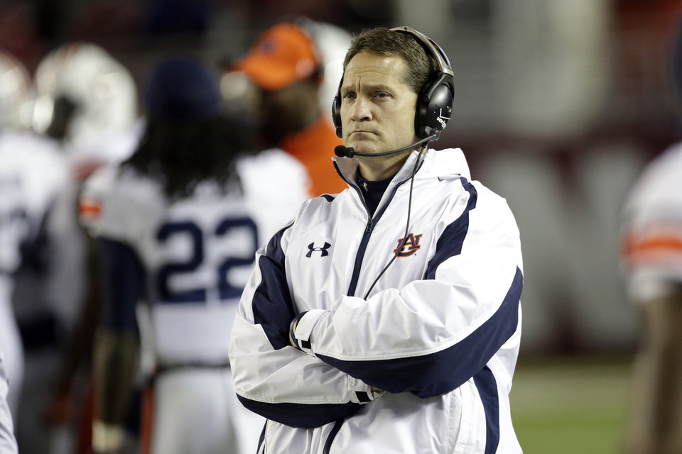 Photo - Auburn coach Gene Chizik watches from the sidelines during the second half of a 49-0 loss to Alabama in a NCAA college football game at Bryant-Denny Stadium in Tuscaloosa, Ala., Saturday, Nov. 24, 2012. Chizik was fired Sunday after a 3-8 season by Athletic Director Jay Jacobs. (AP Photo/Dave Martin)