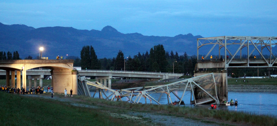 Photo - In this photo provided by Francisco Rodriguez, the scene were the Interstate 5 bridge collapsed into the Skagit River is seen at dusk Thursday, May 23, 2013, in Mount Vernon, Wash. (AP Photo/Francisco Rodriguez)