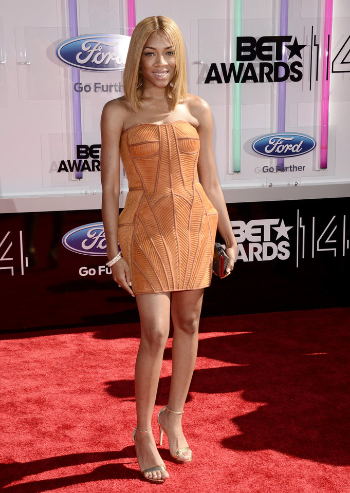 Photo - Lil Mama arrives at the BET Awards at the Nokia Theatre on Sunday, June 29, 2014, in Los Angeles. (Photo by Dan Steinberg/Invision/AP)