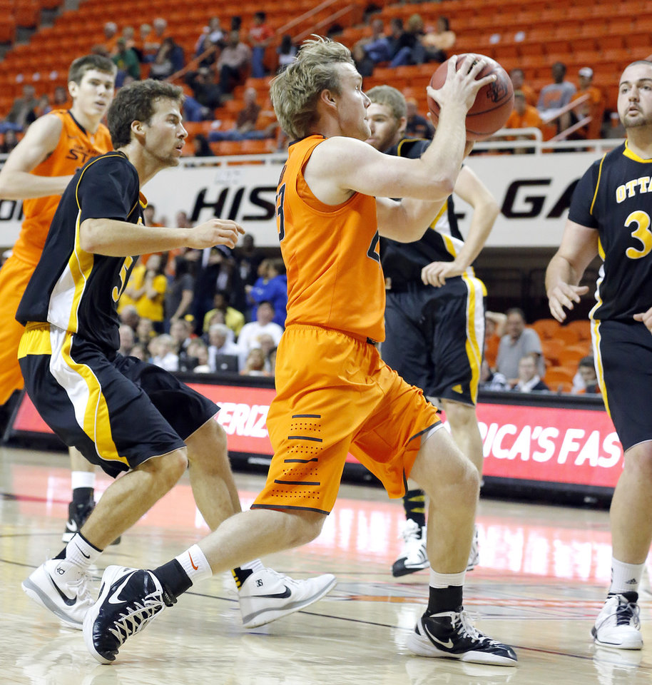 Photo - Oklahoma State's Alex Budke drives to the basket during the college basketball game between Oklahoma State University and Ottawa (Kan.) at Gallagher-Iba Arena in Stillwater, Okla., Thursday, Nov. 1, 2012. Photo by Sarah Phipps, The Oklahoman