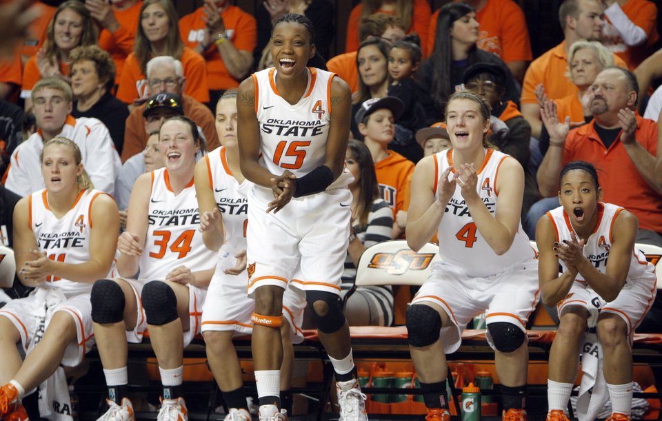Photo - Oklahoma State's Toni Young (15) cheers following the Cowgirls' win over Coppin State during the women's college game between Oklahoma State University and Coppin State at Gallagher-Iba Arena in Stillwater, Okla.,  Saturday, Nov. 26, 2011.  Photo by Sarah Phipps, The Oklahoman