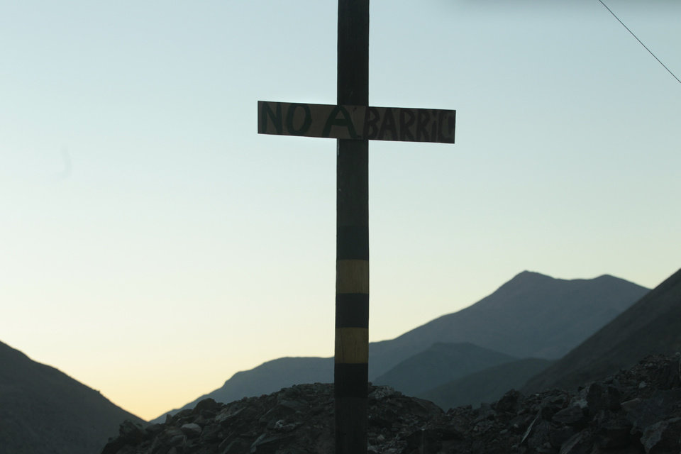 Photo - In this May 23, 2013 photo, a cross that bears the message;