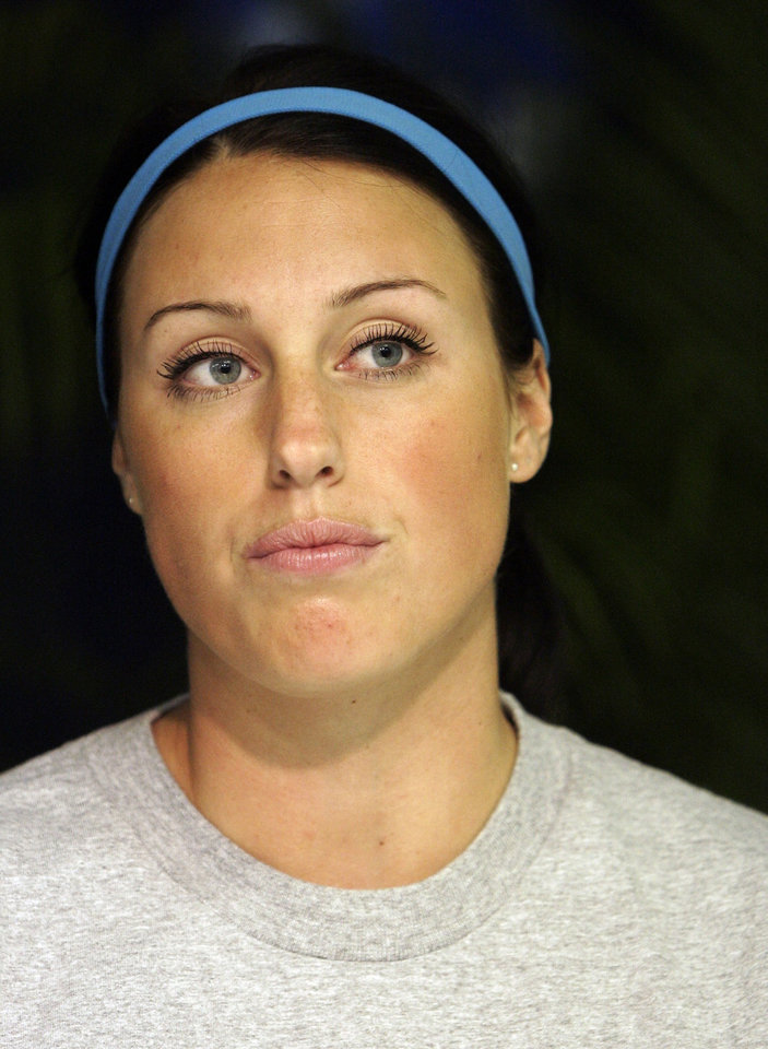 Photo - UNIVERSITY OF WASHINGTON / UW / WOMEN'S SOFTBALL / WCWS / WOMEN'S COLLEGE WORLD SERIES: Washington's Danielle Lawrie listens to a question during a news conference for the NCAA softball championships in Oklahoma City, Wednesday, May 27, 2009. Tournament play begins Thursday. (AP Photo) ORG XMIT: OKSO118