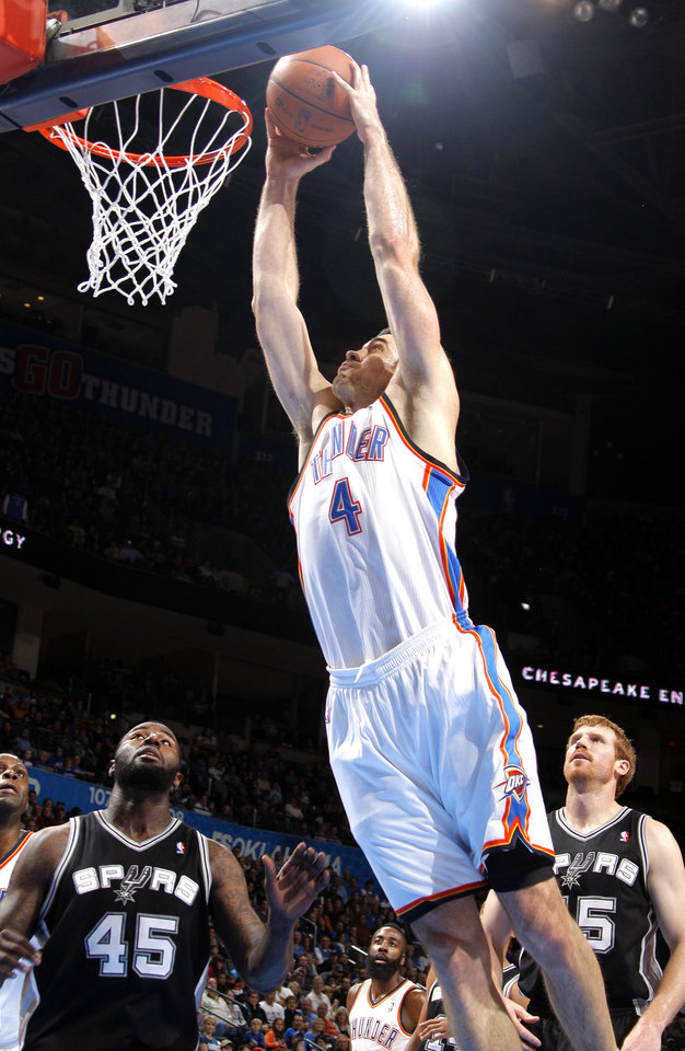 Oklahoma City Thunder\'s Nick Collison (4) dunks in front of San Antonio Spurs\' DeJuan Blair and Matt Bonner (15)during the the NBA basketball game between the Oklahoma City Thunder and the San Antonio Spurs at the Chesapeake Energy Arena in Oklahoma City, Sunday, Jan. 8, 2012. Photo by Sarah Phipps, The Oklahoman