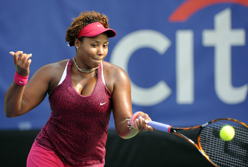 Photo - Taylor Townsend returns a shot against Kristina Mladenovic, of France, during a match at the Citi Open tennis tournament, Wednesday, July 30, 2014, in Washington. (AP Photo/Nick Wass)