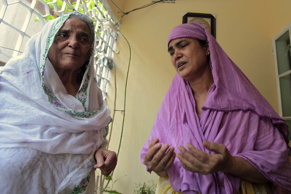 Photo -   Grandmother, left, and aunt of Bangladeshi Quazi Mohammad Rezwanul Ahsan Nafis weep in his home in the Jatrabari neighborhood in north Dhaka, Bangladesh, Thursday, Oct. 18, 2012. The FBI arrested 21-year-old Nafis on Wednesday after he tried to detonate a fake 1,000-pound (454-kilogram) car bomb, according to a criminal complaint. His family said Thursday that Nafis was incapable of such actions. (AP Photo/A.M. Ahad)