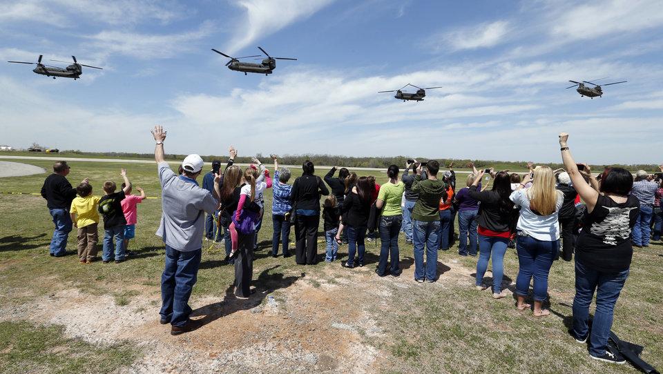 Family members wave at their departing loves ones after a deployment ceremony for the 149th General Support Aviation Battalion (GSAB), as they prepare for deployment to Afghanistan in support of Operation Enduring Freedom on Thursday, April 25, 2013 in Lexington, Okla. Photo by Steve Sisney, The Oklahoman