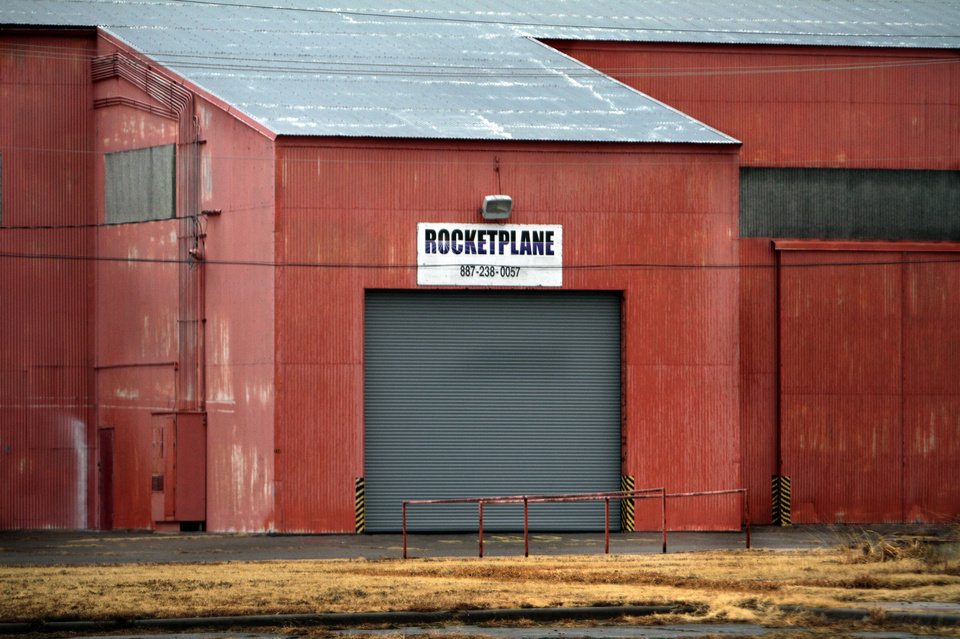 Photo - Left: Paint peels from the home of Rocketplane at the Burns Flat spaceport.  Photos by Steve Sisney,  The Oklahoman