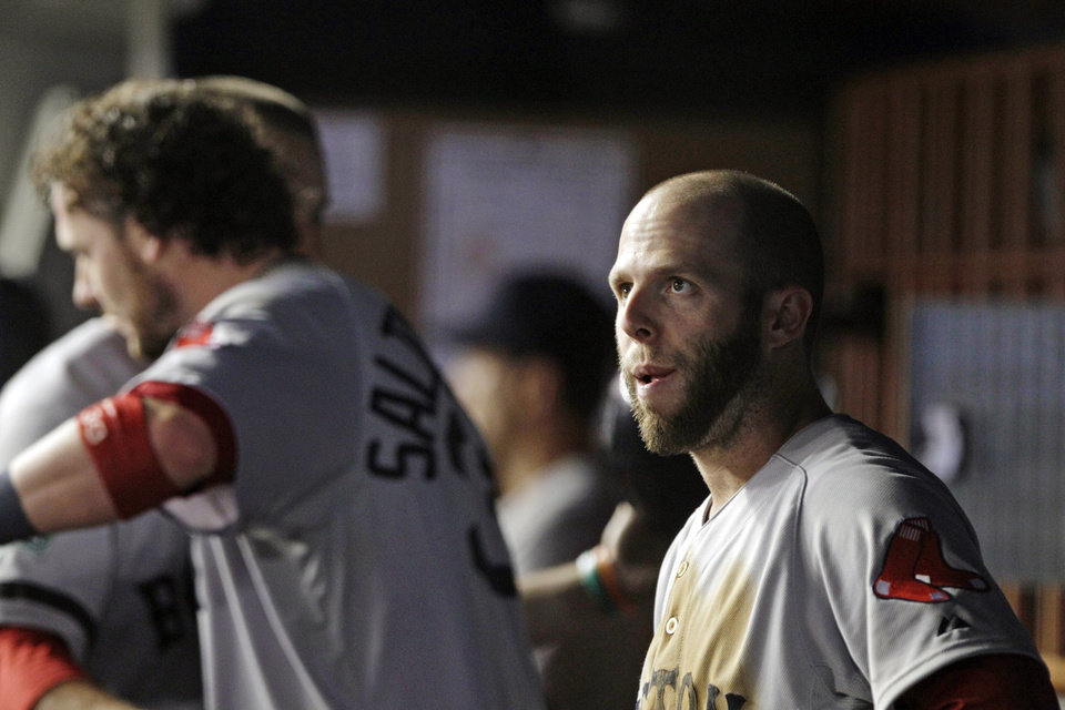 Boston Red Sox\'s Dustin Pedroia watches from the dugout along with teammates during the ninth inning of a baseball game against the New York Yankees, Wednesday, Oct. 3, 2012, in New York. The Yankees won 14-2. (AP Photo/Frank Franklin II)