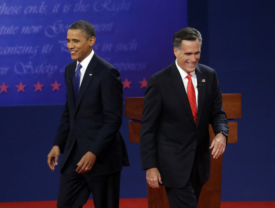 Photo -   Republican presidential candidate, former Massachusetts Gov. Mitt Romney, right, and President Barack Obama, left, walk on stage at the end of their first debate at the University of Denver, Wednesday, Oct. 3, 2012, in Denver. (AP Photo/Pablo Martinez Monsivais)