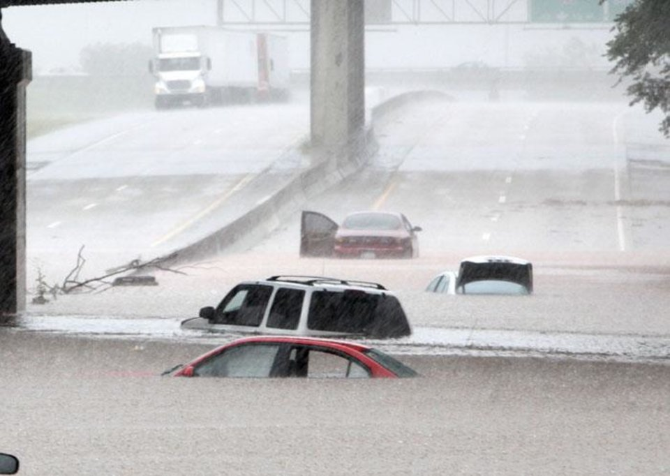 Photo -  RAIN / FLOOD / FLOODING: Cars are almost covered in water under the railroad bridge at the Broadway Extension in Oklahoma City, OK, Monday, June 14, 2010. By Paul Hellstern, The Oklahoman ORG XMIT: KOD