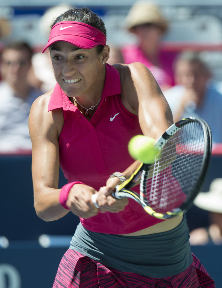 Photo - Caroline Garcia, of France, returns to Angelique Kerber, from Germany,  during second round play at the Rogers Cup tennis tournament Wednesday, Aug. 6, 2014 in Montreal. (AP Photo/The Canadian Press, Paul Chiasson)