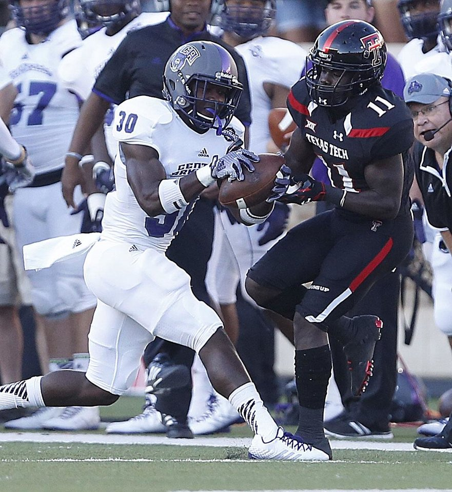 Photo - Central Arkansas' Artez Williams intercepts a pass from Texas Tech's Jakeem Grant during an NCAA college football game in Lubbock, Texas, Saturday, Aug. 30, 2014. (AP Photo/Lubbock Avalanche-Journal, Tori Eichberger) ALL LOCAL TELEVISION OUT