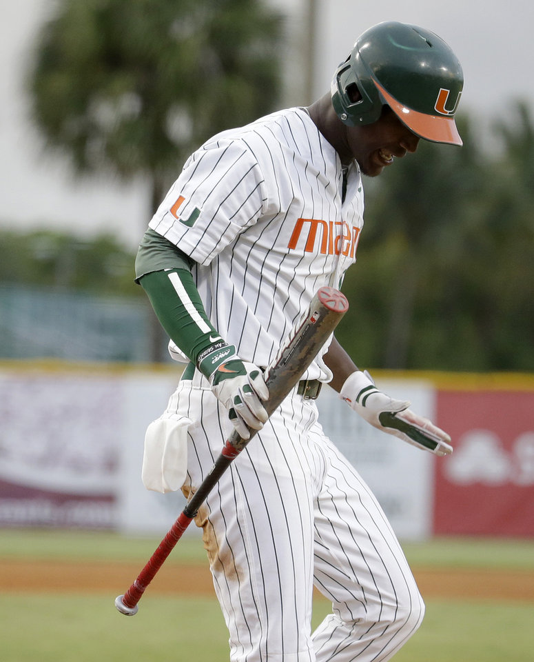 Photo - Miami's Dale Carey reaxcts after striking out in the second inning against Texas Tech during an NCAA college baseball regional tournament in Coral Gables, Fla., Saturday, May 31, 2014. (AP Photo/Lynne Sladky)