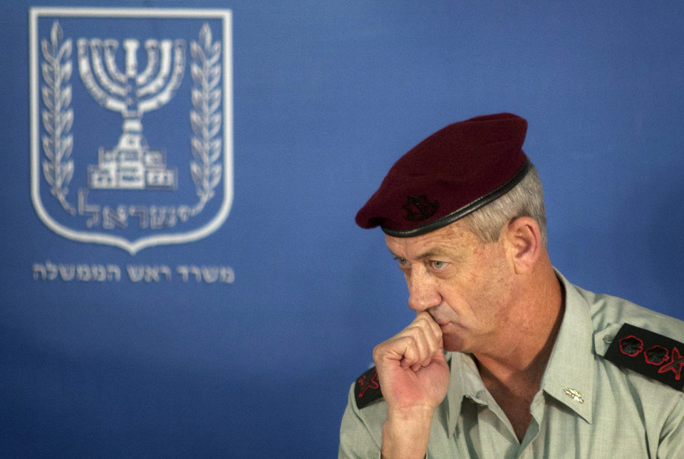 Photo -   FILE - In this Feb. 14, 2011 file photo, Israeli Chief of Staff Lt. Gen. Benny Gantz looks on during a change of the epaulets ceremony in the Prime Minister's office in Jerusalem. Israel's military chief has hinted that other countries could also strike Iran's nuclear sites to keep the country from acquiring atomic weapons. (AP Photo/Sebastian Scheiner, File)