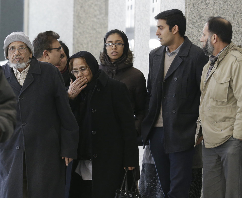 Family members and supporters of Chicago businessman Tahawwur Rana leave after Rana\'s sentencing in federal court Jan. 17, 2013 in Chicago. U.S. District Court Judge Harry D. Leinenweber sentenced Rana to 14 years for his role in aiding a terrorist group that took credit for the deadly 2008 attacks in Mumbai, India. Rana was cleared in 2011 of involvement in the Mumbai siege that killed more than 160 people, but he was convicted of lesser charges. They included providing material support to a Pakistani militant group that took responsibility for the Mumbai attack and a planned attack in Denmark. (AP Photo/M. Spencer Green)