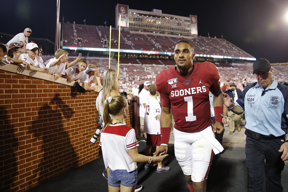 Photo - Oklahoma's Jalen Hurts (1) leaves the field after a college football game between the University of Oklahoma Sooners (OU) and the Houston Cougars at Gaylord Family-Oklahoma Memorial Stadium in Norman, Okla., Sunday, Sept. 1, 2019. Oklahoma won 49-31. [Bryan Terry/The Oklahoman]