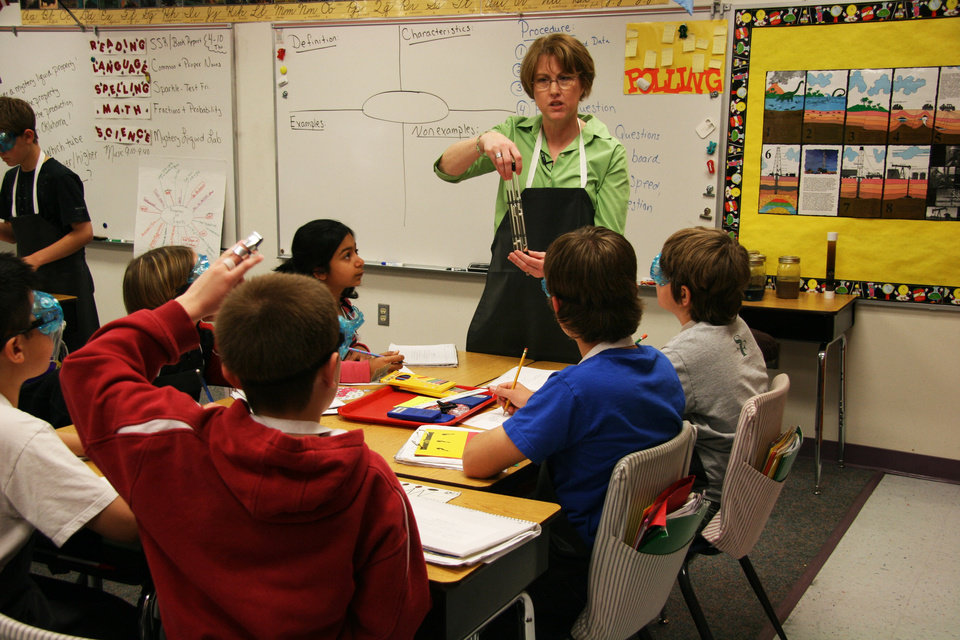 Photo - Fifth-grade teacher Jeri Doane explains an experiment to her students at Angie Debo Elementary in Edmond.  The experiment was developed by the Oklahoma Energy Resources Board. Photo provided