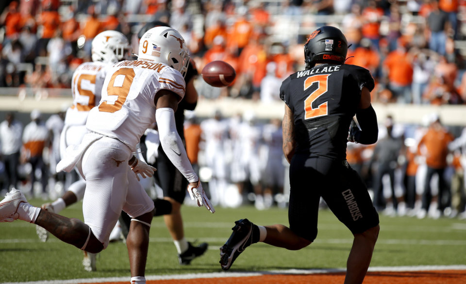 Photo - Oklahoma State's Tylan Wallace (2) scores a touchdown in the first quarter in front of Texas' Josh Thompson (9) during the college football game between the Oklahoma State University Cowboys and the University of Texas Longhorns at Boone Pickens Stadium in Stillwater, Okla., Saturday, Oct. 31, 2020. Photo by Sarah Phipps, The Oklahoman