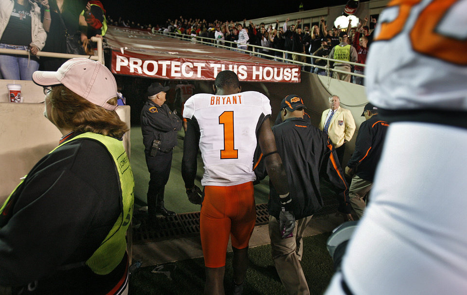 Photo - Oklahoma State's Dez Bryant (1) walks off the field after the 56-20 loss to Texas Tech during the college football game between the Oklahoma State University Cowboys (OSU) and the Texas Tech Red Raiders at Jones AT&T Stadium on Saturday, Nov. 8, 2008, in Lubbock, Tex.BY CHRIS LANDSBERGER/THE OKLAHOMAN