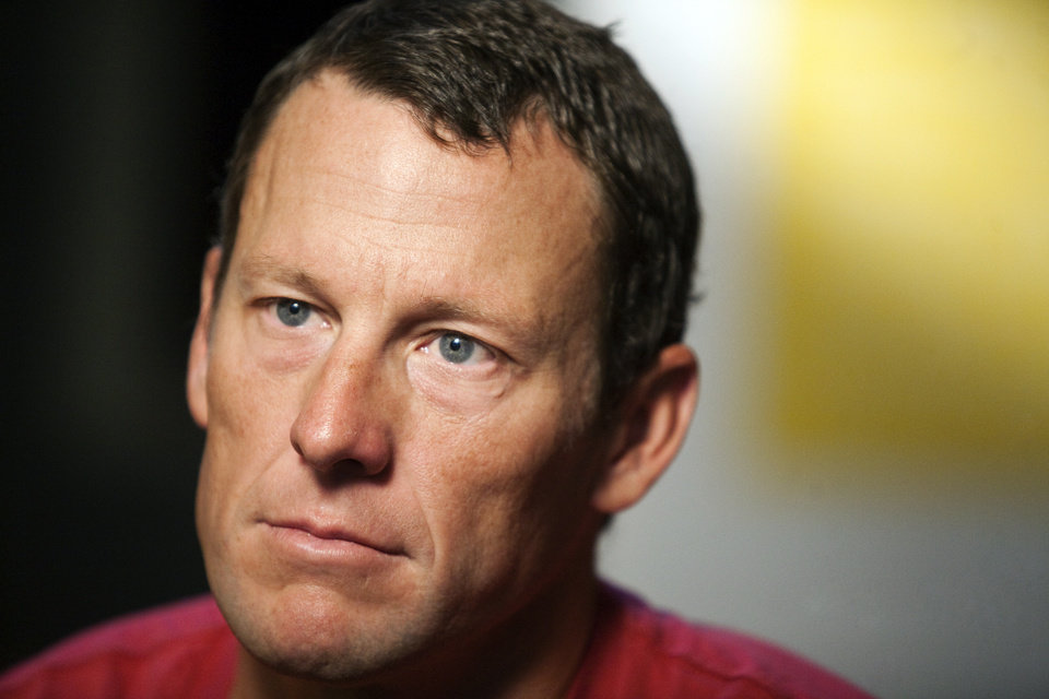 Photo - FILE - In this Feb. 15, 2011 file photo, Lance Armstrong pauses during an interview in Austin, Texas. Local and international news crews are staking out positions in front of Armstrong's lush, Spanish-style villa ahead of the cyclist's interview with Oprah Winfrey later Monday, Jan. 14, 2013.  (AP Photo/Thao Nguyen, File)