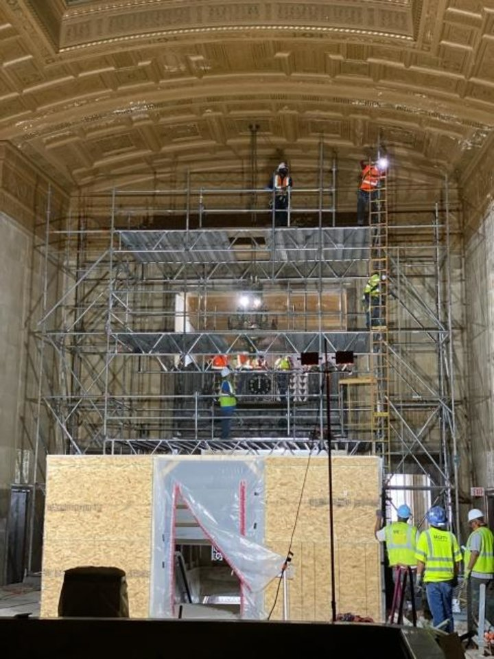 Photo -  Deterioration of the ceiling at Great Banking Hall can be seen as workers are shown removing light fixtures for cleaning and repair. [PROVIDED]