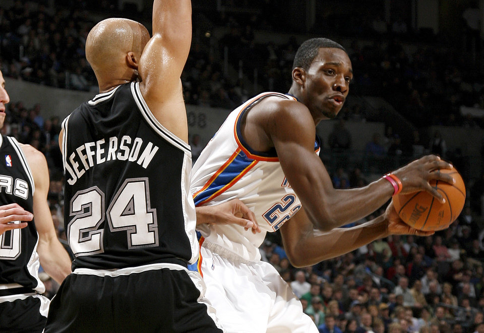 Oklahoma City's Jeff Green looks to pass around San Antonio's Richard Jefferson during the NBA basketball game between the Oklahoma City Thunder and the San Antonio Spurs at the Ford Center in Oklahoma City, Wednesday, January 13, 2010. Photo by Bryan Terry, The Oklahoman