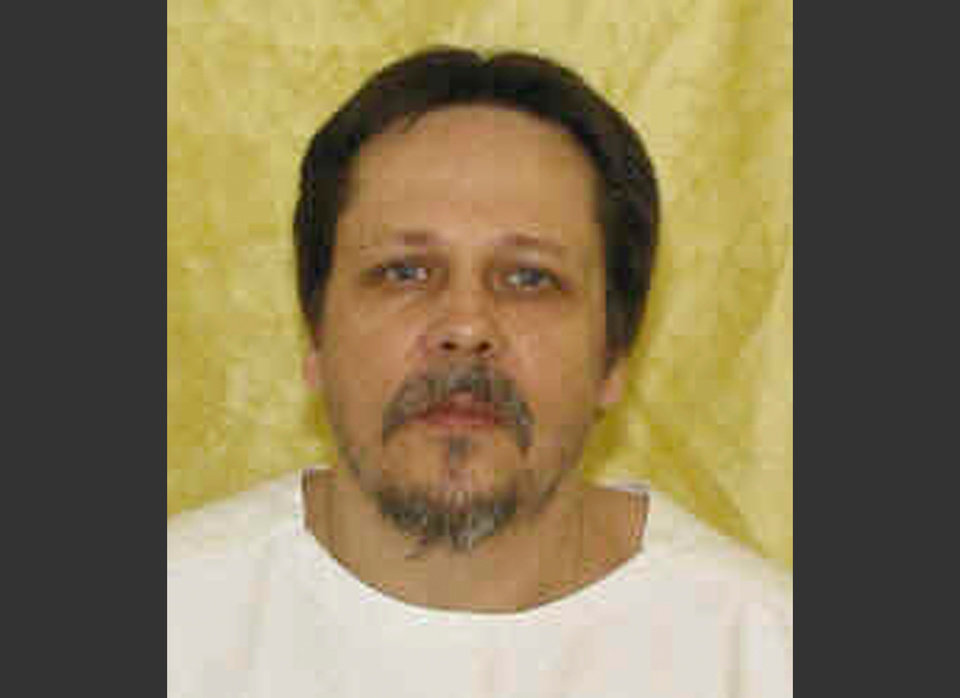 Photo - FILE - This undated file photo provided by the Ohio Department of Rehabilitation and Correction shows inmate Dennis McGuire. McGuire appeared to gasp several times and took an unusually long time to die — more than 20 minutes — in an execution carried out Thursday, Jan. 16, 2014, with a combination of drugs never before tried in the U.S. An attorney for McGuire's family said it plans to sue the state over what happened. (AP Photo/Ohio Department of Rehabilitation and Correction, File)