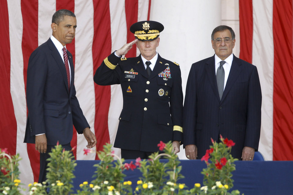 Photo -   President Barack Obama arrives on stage at the Memorial Day Observance at the Memorial Amphitheater at Arlington National Cemetery, Monday, May 28, 2012. At center is Chairman of the Joint Chiefs of Staff Gen. Martin Dempsey and Defense Secretary Leon Panetta is at right. (AP Photo/Charles Dharapak)