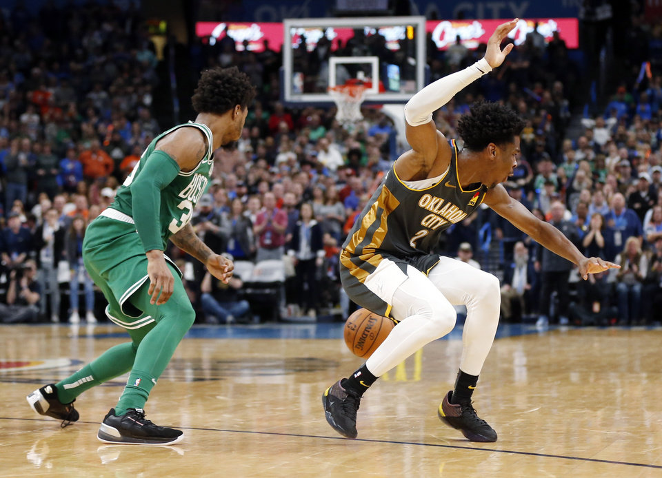 Photo - Boston's Marcus Smart (36) steals the ball from Oklahoma City's Shai Gilgeous-Alexander (2) late in the fourth quarter during an NBA basketball game between the Oklahoma City Thunder and the Boston Celtics at Chesapeake Energy Arena in Oklahoma City, Sunday, Feb. 9, 2020. Boston won 112-111. [Nate Billings/The Oklahoman]