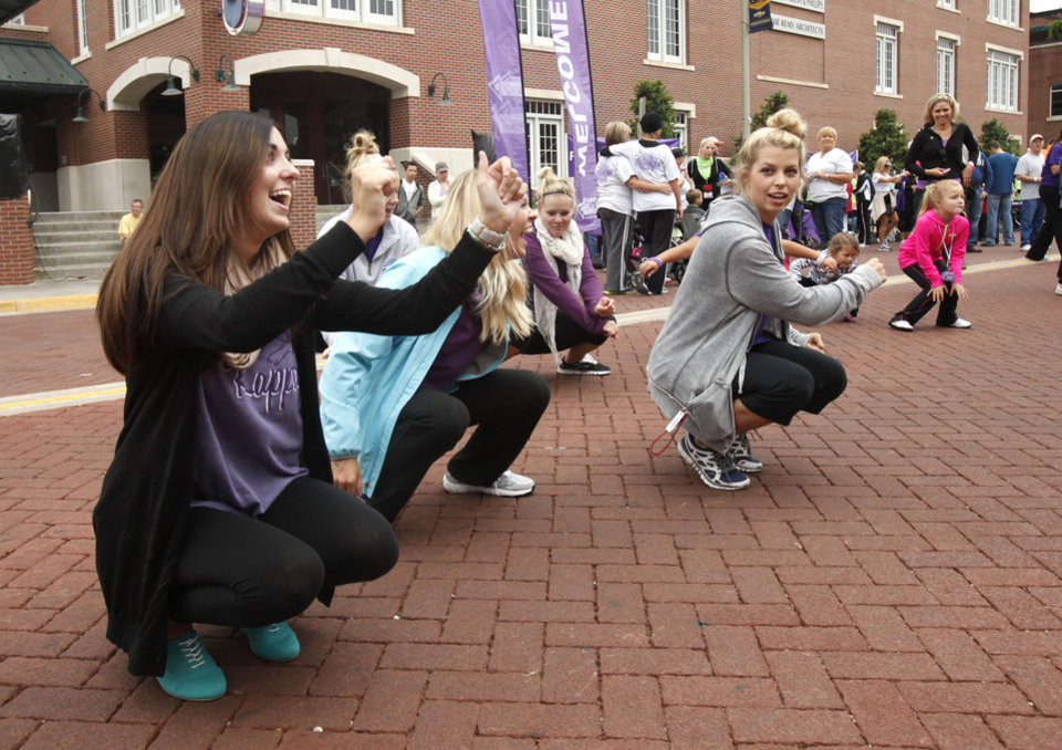 Walkers dance to music before the 2012 Oklahoma City Walk to End Alzheimer\'s at Bricktown Ballpark in Oklahoma City, OK, Saturday, September 15, 2012, By Paul Hellstern, The Oklahoman